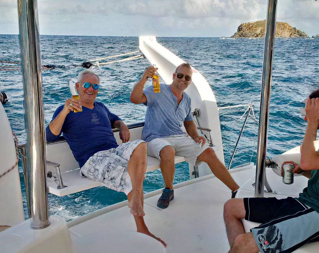 Our guests enjoying beverages during a recent sail. The large cockpit and benches on our 46' catamaran ensure comfort and safety, as well as making sure clients can enjoy the beautiful days we experience every day