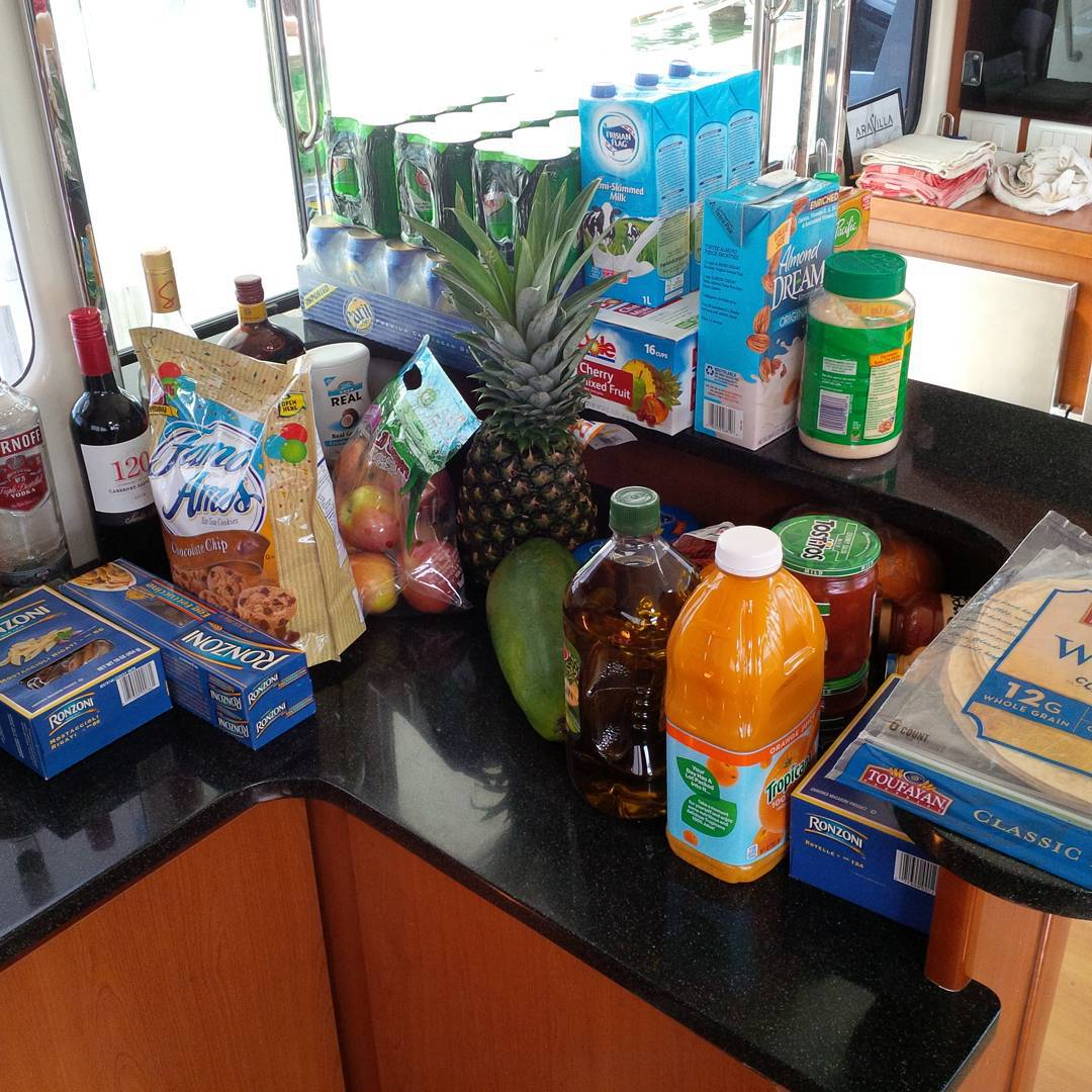 Provisioning for charter has begun. How do you feed 9 people for one week without going ashore? Lots of food and drink!!