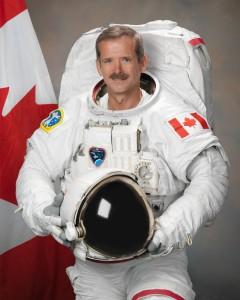 Photograph official portrait of Canadian Astronaut Chris Hadfield in EMU suit.  Photo Date: July 19, 2011.  Location: Building 8, Room 183 - Photo Studio.  Photographer: Robert Markowitz